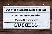 The Secret Of Success quote by Swami Sivananda Inspirational message written on vintage wooden board. Motivational concept image poster