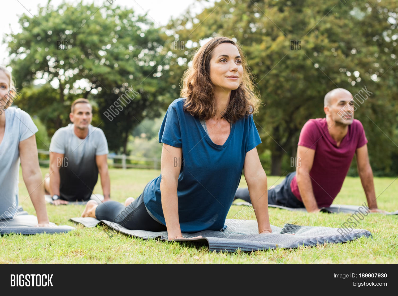 mature healthy people doing yoga image & photo | bigstock
