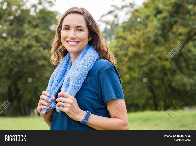 happy mature woman smiling park image & photo | bigstock