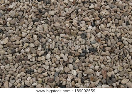 Pebbles/ Small decorative white, grey and black pebbles.