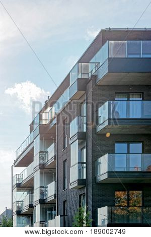 Vilnius, Lithuania - September 30, 2016: Fragment of Modern glass architecture of residential building. And outdoor facilities.