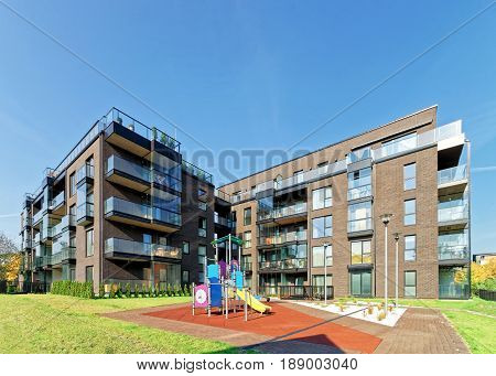 Vilnius, Lithuania - September 30, 2016: Children playground and Modern architecture of residential building. And outdoor facilities.