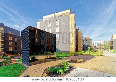 Vilnius, Lithuania - September 30, 3016: Benches at european complex of residential buildings. And outdoor facilities.