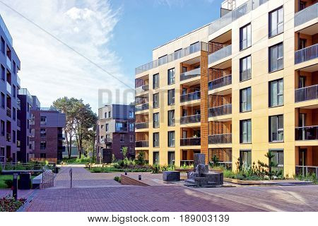Vilnius, Lithuania - September 30, 3016: Benches at european complex of apartment residential buildings. And outdoor facilities.
