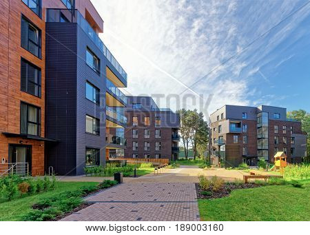 Vilnius, Lithuania - September 30, 3016: Benches at Modern european complex of apartment buildings. And outdoor facilities.