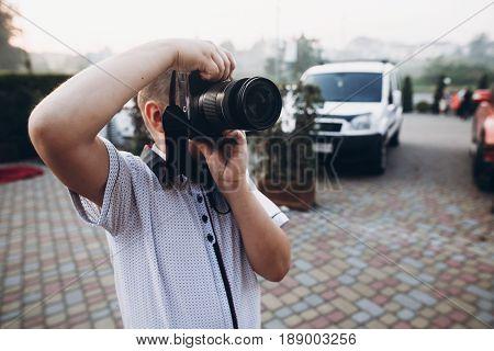 Boy Holding Big Photo Camera, Playing As Wedding Photographer At Wedding Reception, Photo Booth