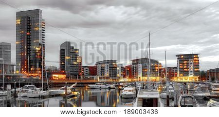 Luxury marina at sundown with vibrant lighting with partially desaturated colors