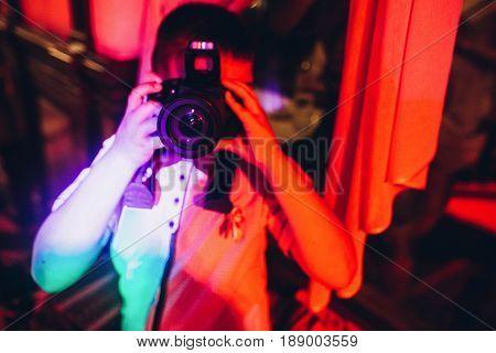 Boy Holding Big Photo Camera, Playing As Wedding Photographer At Wedding Reception, Party Disco Ligh