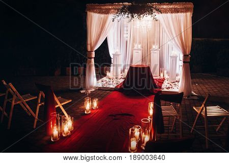 Wedding Evening Ceremony, Venue Aisle With Candles In Glass Lanterns And Arch, Stylish Wedding Decor
