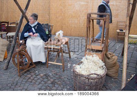 Italy Bologna - November 20 2016: knitter women on their work on market on November 20 2016 in Bologna Emilia Romagna Italy.