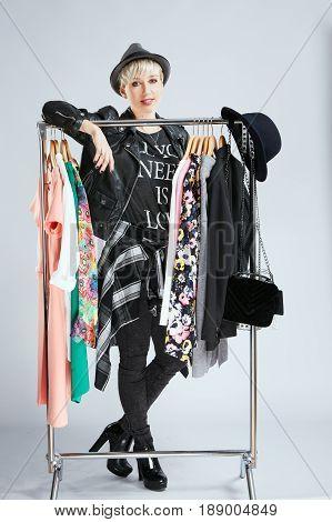 Stylist Standing Behind Dresses On Rack