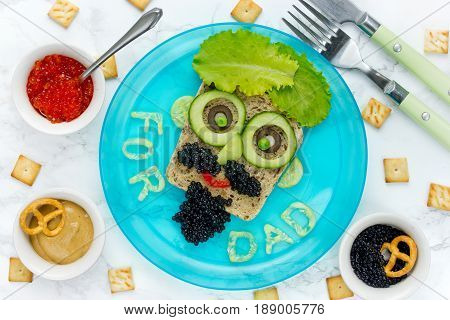 Happy Father's Day treat for dad man face sandwich top view