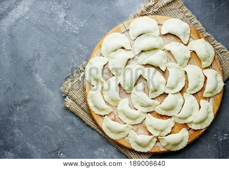Raw meat dumplings or vareniki with stuffing russian traditional pelmeni with meat