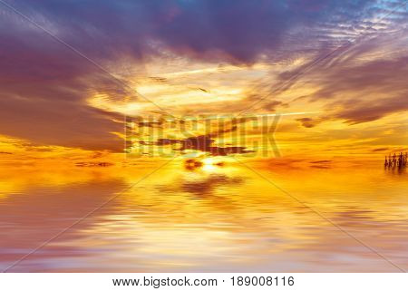 Amazing colorful sea sunset landscape with fantactic colors in the sky and reflection in the water. Beauty world natural outdoors travel background