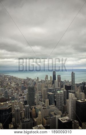 Aerial view of skyscrapers and buildings by the lake Michigan in downtown Chicago, Illinois, USA during the day