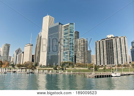 Skyscrapers and buildings by the lake Michigan in downtown Chicago, Illinois, USA during the day