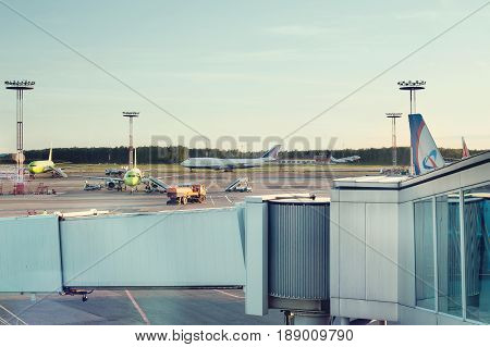 MOSCOW, RUSSIA - May 28, 2017: Airplane is under loading in Domodedovo airport. The Domodedovo International Airport is one of the three major Moscow airports