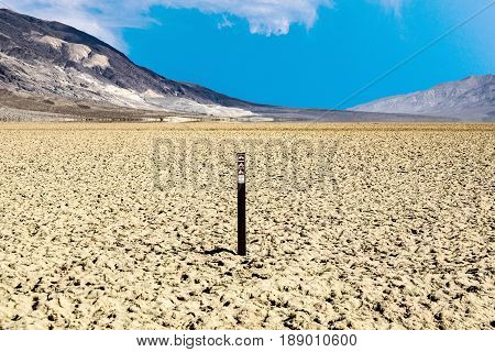 view over the dried salt see of Searles Lake to the panamid mountains it is forbidden to enter the area
