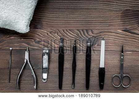 manicure and hands care set with nippers, cuticle scissors on wooden table background top view
