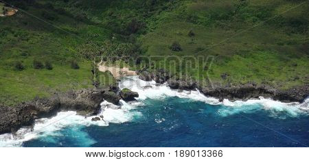 Aerial view, Hidden Beach, Saipan An aerial view of the Hidden Beach in Saipan, Northern Mariana Islands showing rugged cliffs and huge waves from the Pacific Ocean