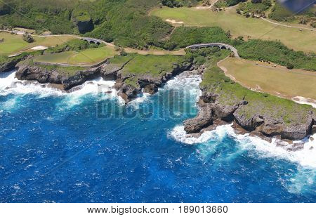 Scenic views of Saipan eastern coast Saipan's east coast is a display of lush scenery, golf courses with steep cliff lines with waves rolling in from the Pacific Ocean.