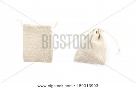 Cloth gift bag with a lace stringing isolated over the white background, set of two different foreshortenings