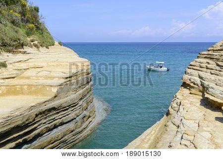 SIDARI, GREECE - MAY 24: Tourists enjoying the beautiful weather visit the Canal d'amour on May 24, 2017 in Sidari, Corfu island in Greece.