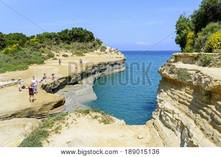 SIDARI, GREECE - MAY 24: Tourists enjoying the beautiful weather visit the Canal d'amour on May 24, 2017 in Sidari, Corfu island in Greece.