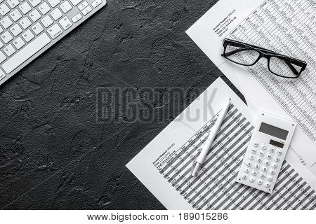 business accounter work with taxes and keyboard on black office desk background top view mock up