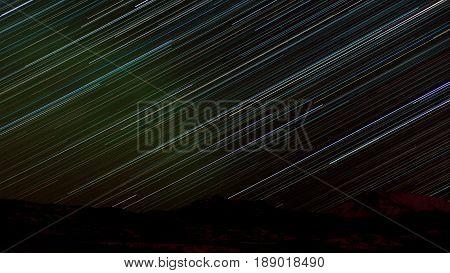Star Trails In Sky Over Dark Yukon Taiga Landscape