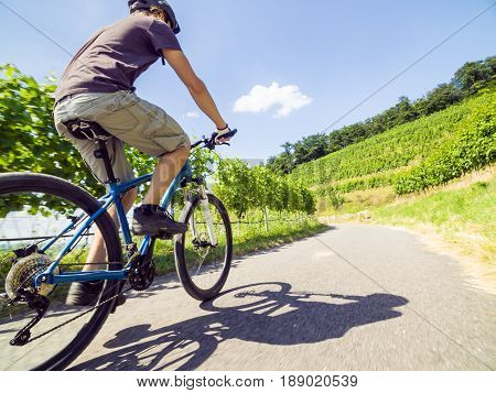 Young man riding his blue mountain bike