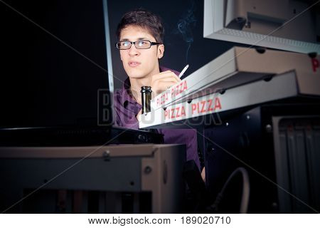 nerd sitting in front of his computers all night long