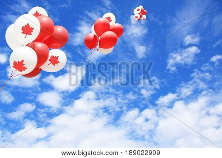 Canadian maple leaf flag balloons in the sky for Canada day.