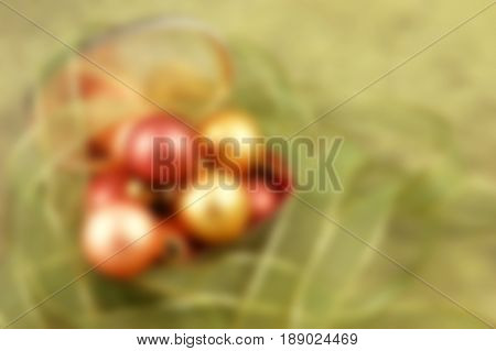 Christmas ornaments in a silver gift box surrounded by ribbon - blurred image background