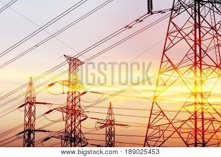 Abstract scene of silhouette electric pylon with the twilight sky before the sun set.The elctric power concept.