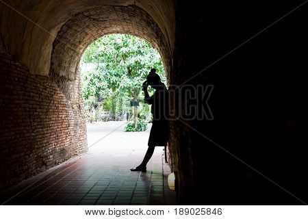 Silhouette Women Shadow Stand In Sorrow Or Terrible Mood Action In Tunnel