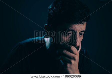 Close Up Of Sad Man In Dark Room. Depression And Anxiety Disorder Concept