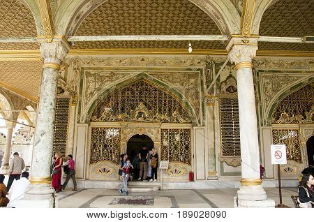 Istanbul, Turkey - May 7, 2017: Tourist getting their photographed taken outside Imperial Divan in Topkapi Palace Istanbul