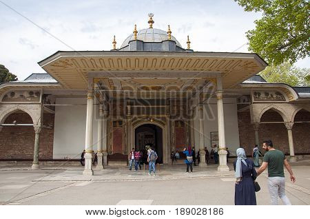 Istanbul, Turkey - May 7, 2017: Visitor entering the Gate of Felicity in the second courtyard of Topkapi palace
