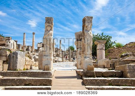 Ephesus. Aydin, Turkey - May 10, 2017: Tourists walking around of  Hercules Gate in   Ephesus , Kusadasi Turkey