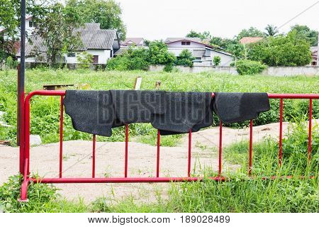 Grey carpet on red fence carpet dry out in the sun easily expose the carpets on steal fence