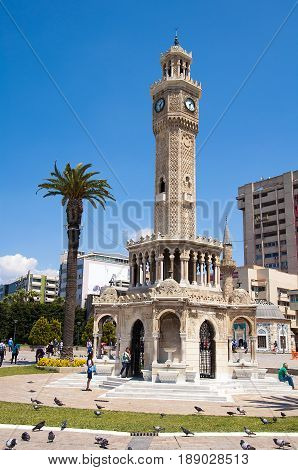Izmir, Turkey - May 7, 2017: Konak Square with tourists walking near the historical clock tower. It was built in 1901 and accepted as the symbol of Izmir City