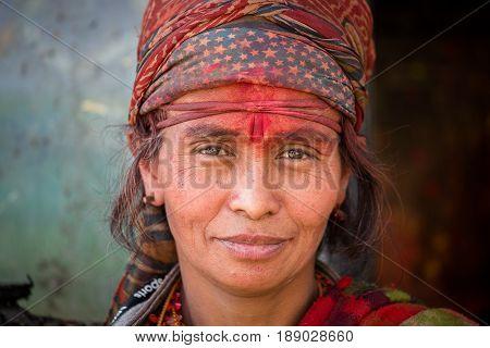 KATHMANDU NEPAL - OCTOBER 25 2016 : Portrait old poor women in traditional dress in street Kathmandu Nepal