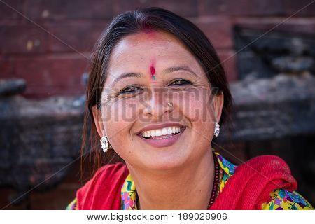 KATHMANDU NEPAL - OCTOBER 25 2016 : Portrait old women in traditional dress in street Kathmandu Nepal