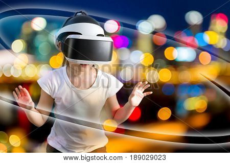 Concept of VR or virtual reality illustrated by Asian child wearing VR headset exploring virtual world.