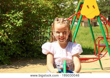 The Seven year old girl on a swing