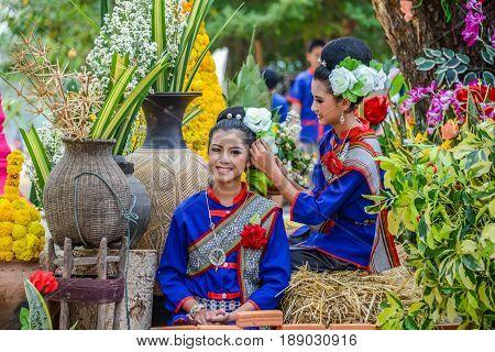 NAKORN PHANOM THAILAND - FEBRUARY 14 2015: Thai northeastern Phutai dancer with traditional costume in Phutai world event day in Renunakorn of Nakorn Phanom Thailand.