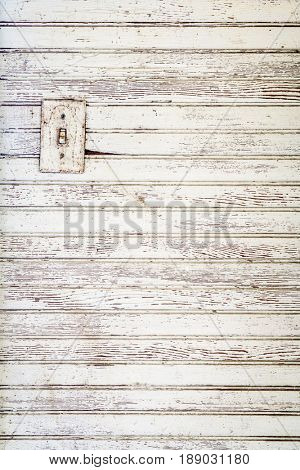 grunge white painted wood wall background with an electric switch