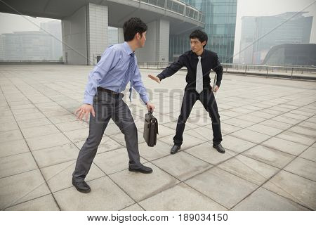 Chinese business people arguing