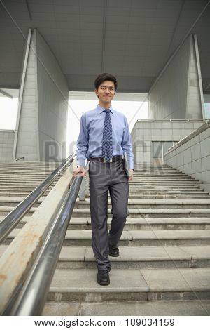 Chinese businessman on city steps